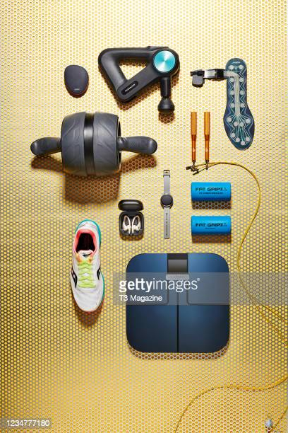 Group of health and fitness gadgets, including a Garmin Vivoactive 4S smartwatch, Beats Powerbeats Pro headphones, Saucony Endorphin Pro running...