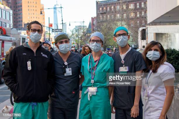A group of healthcare workers from the Lenox Health Greenwich Village Hospital pose together during the 7pm nightly cheer amid the coronavirus...