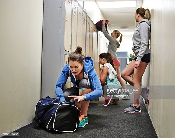 group of healthy fit females in locker room - gym bag stock pictures, royalty-free photos & images