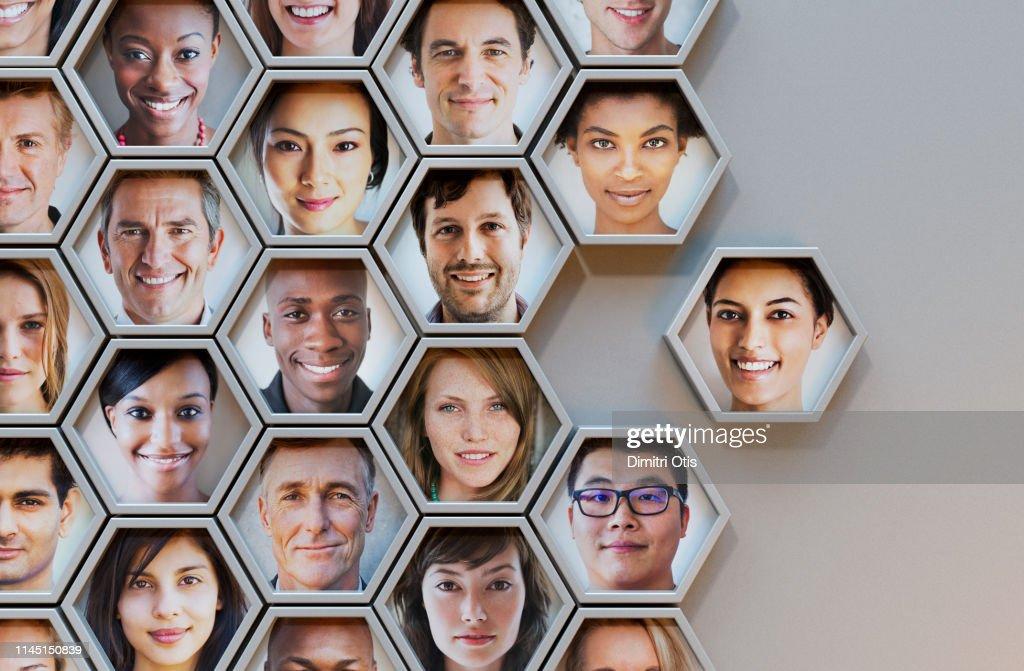 Group of hexagonal portrait pods, one joining : Foto de stock