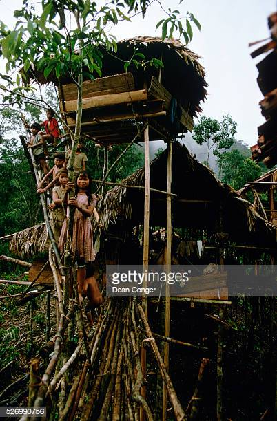 Group of Higaonon children on a footbridge outside a tree house in Mindanao, the Philippines.