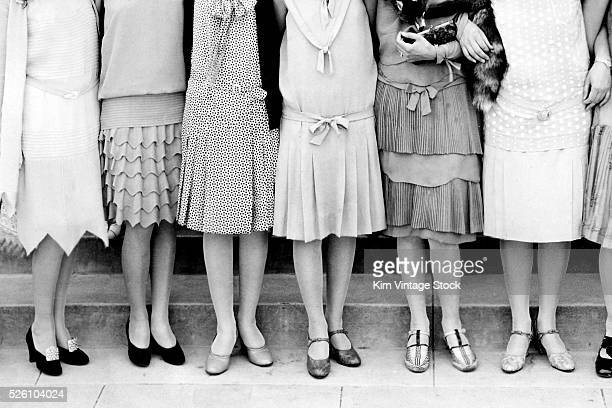 A group of high school flapper girls pose for a formal portrait ca 1925