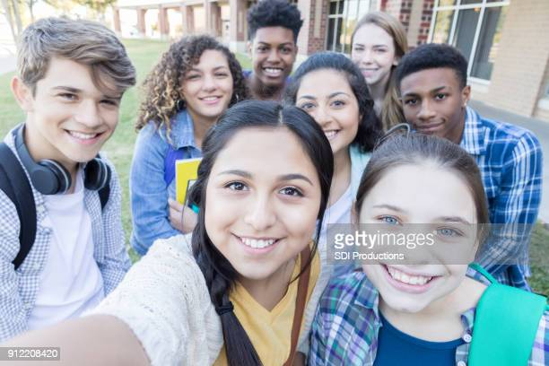 group of high school friends take selfie together - cute highschool girls stock photos and pictures