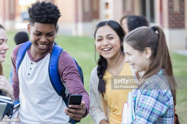 Group of high school friends wait for school to start
