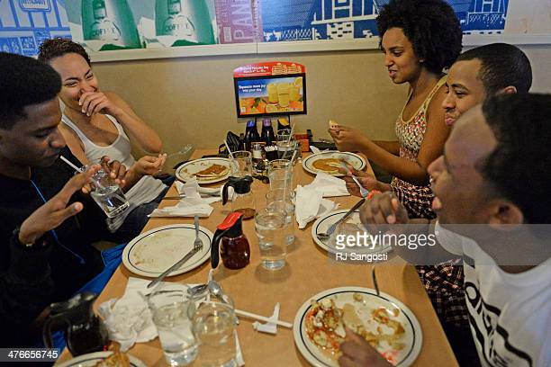 A group of high school seniors from Thomas Jefferson High School take advantage of a free meal during their lunch break on National Pancake Day IHOP...