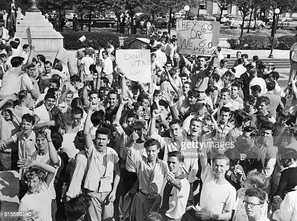 A group of high school students from north and Northwestern sections of Baltimore are shown grouped in front of City Hall shouting their demands that...