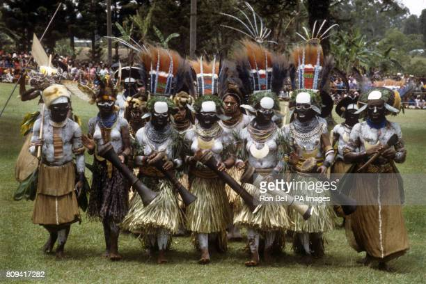 A group of Highland tribal dancers perform for The Queen during the Singsing held at the Old Golf course Mt Hagen Papua New Guinea