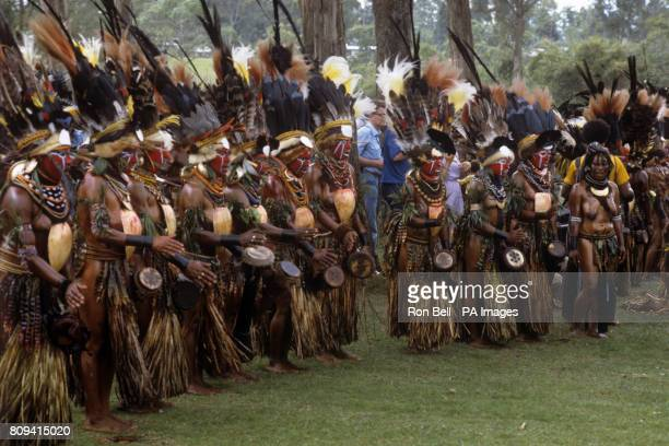 A group of Highland tribal dancers perform in front of The Queen during the Singsing held at the Old Golf course Mt Hagen Papua New Guinea