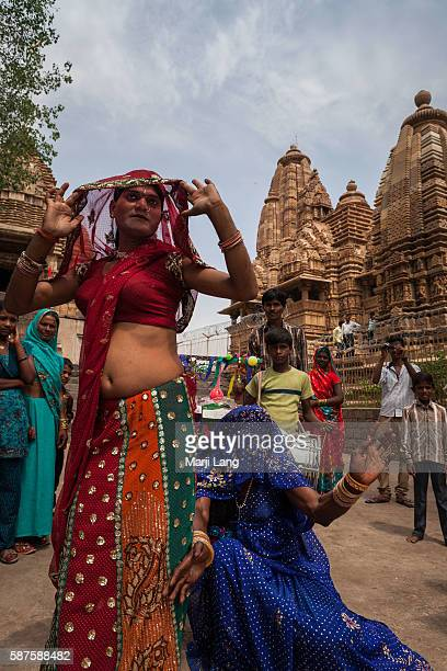 Group of hijras dancing in front of Khajuraho temples in Madhya Pradesh, India.