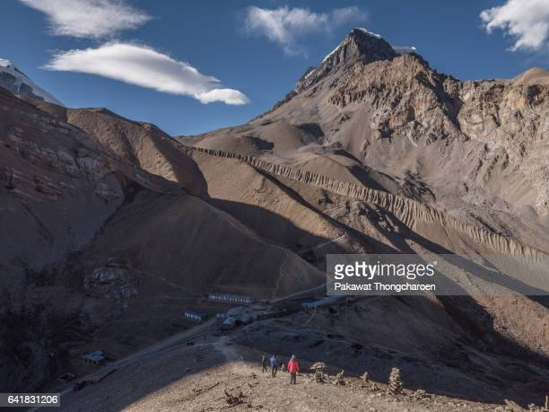 a group of hikers at thorong high camp, annapurna conservation area, nepal - annapurna circuit stock photos and pictures