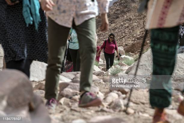 A group of hikers led by Egyptian Bedouin women guides walk in Wadi elSahu in South Sinai governorate on March 29 during the first Sinai Trail led by...