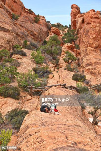 Group of hikers taking a break on the Double O trail. Arches National Park. Utah.