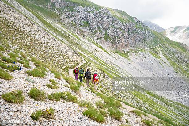 Group of hikers walking in the Abruzzi mountains, Italy