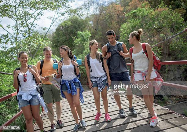 group of hikers walking outdoors - portare foto e immagini stock