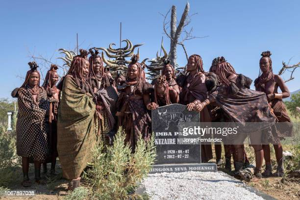 Group of Himba women beside a tomb mourning the death of an old woman.