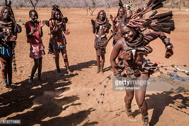 Group of Himba women dancing during the day
