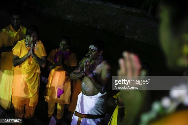 A group of Hindu devotees perform a prayer prior to walking up to the Batu Caves Temple during the festival of Thaipusam in Kuala Lumpur Malaysia on...