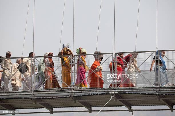 Group of Hindu pilgrims passing the bridge during Kumbh Mela