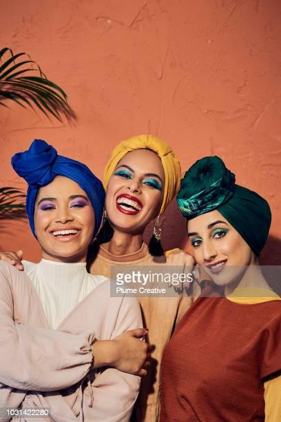 Group of hip Muslim women laughing