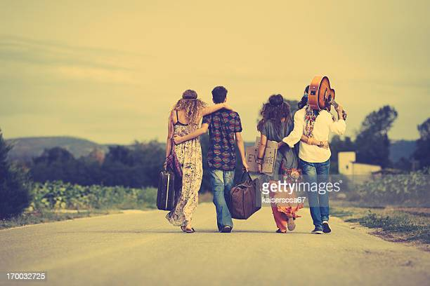 Group of hippie friends walk away