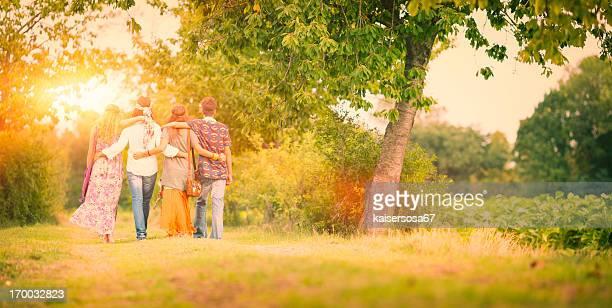 Group of hippie friends walk away