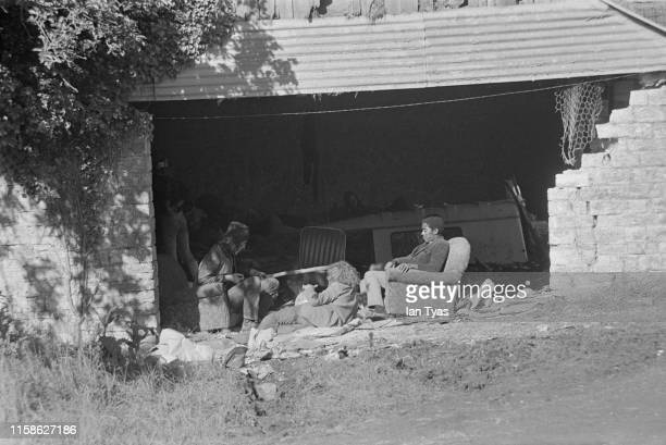 Group of hippies relaxing in armchairs in a farm building during the Glastonbury Fair music festival, 22nd - 26th June 1971. Later renamed the...