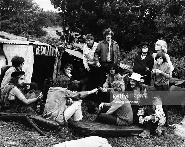 A group of hippies talk and smoke marijuana outside their camp at the Isle of Wight pop festival