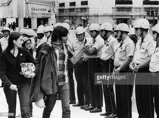 A group of hippies taunting policemen during the trial of the Chicago Seven a group of radicals arrested during the protests against the Vietnam war...