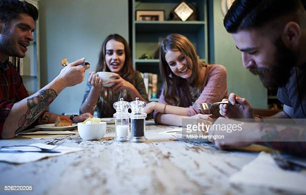Group of hipster friends in cafe