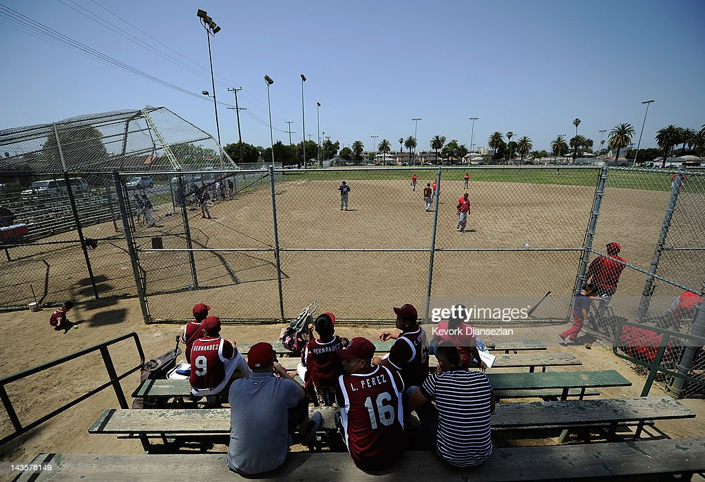 A group of hispanic baseball players play a game in the Jackie Tatum Harvard recreation center in South Los Angeles on April 29, 2012 in Los Angeles, California. It's been 20 years since the verdict was handed down in the Rodney King case that sparked the infamous Los Angeles riots.
