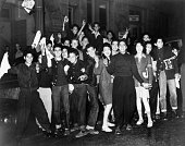Group of hispanic teenagers carry white flags and surrender at the picture id515219694?s=170x170
