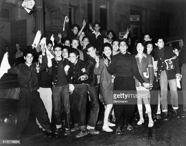 A group of Hispanic teenagers carry white flags and 'surrender' at the Los Angeles central jail during the climax of the Zuit Suit Riots In June of...