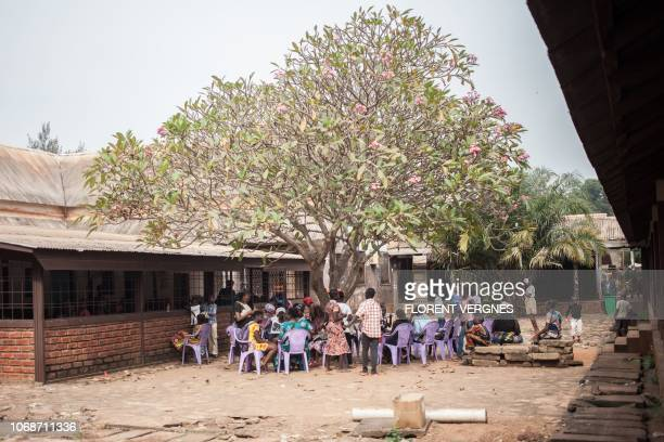 A group of HIVpositive children wait under a tree to receive their antiretroviral drugs at the Bangui paediatric complex on December 4 2018