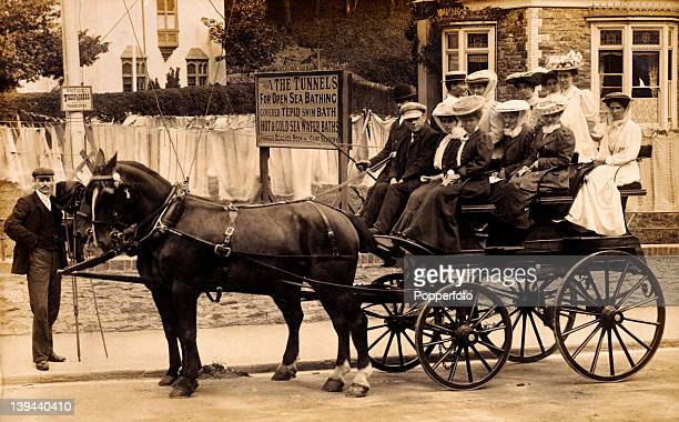 Group of holidaymakers riding in a charabanc in Ilfracombe on 14th August 1906.