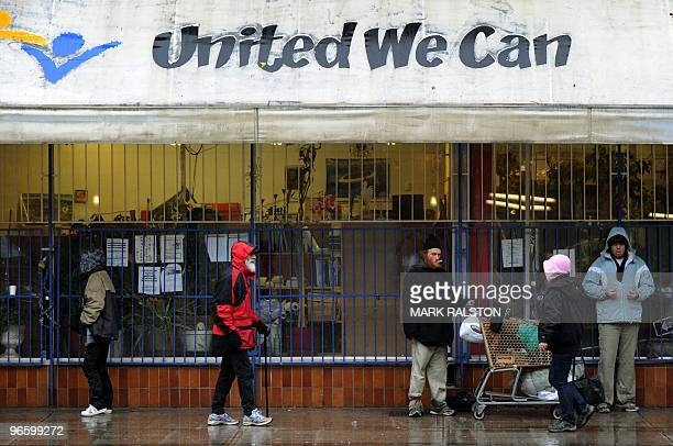 Group of homeless and poor seek shelter from the rain outside a store in the Downtown Eastside area of Vancouver on February 11, 2010. Canada is...