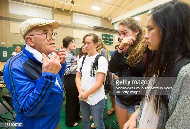 """Group of Homestead High students remained long after the screening of """"Near Normal Man"""" to hear Holocaust survivor Ben Stern tell more stories of his..."""