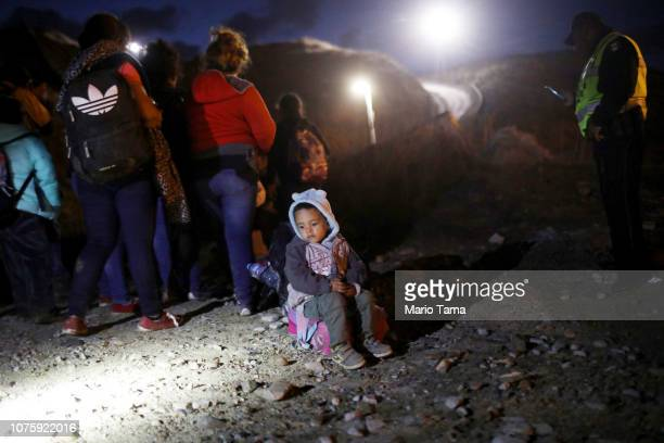Group of Honduran migrants, including children, who said they were part of the 'migrant caravan', are briefly detained along the U.S.-Mexico border...