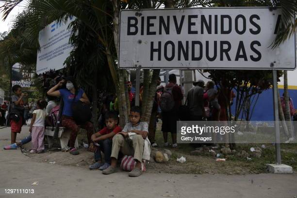 Group of Honduran migrants rest as waiting to return to their country on January 18, 2021 in El Florido, Guatemala. The caravan departed from...