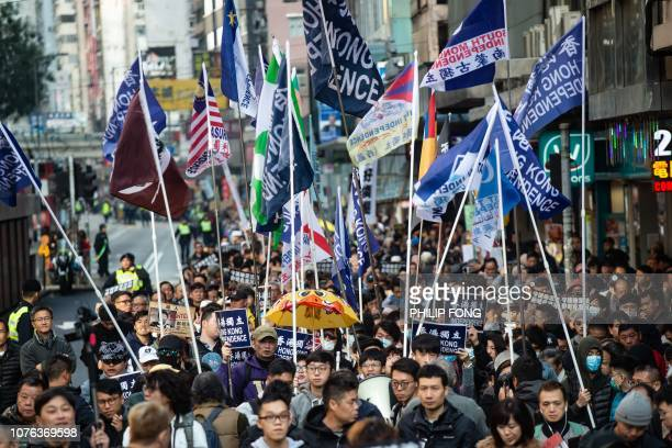 A group of Hong Kong independence supporters display flags during the annual New Year's Day prodemocracy rally in Hong Kong on January 1 2019 Hong...