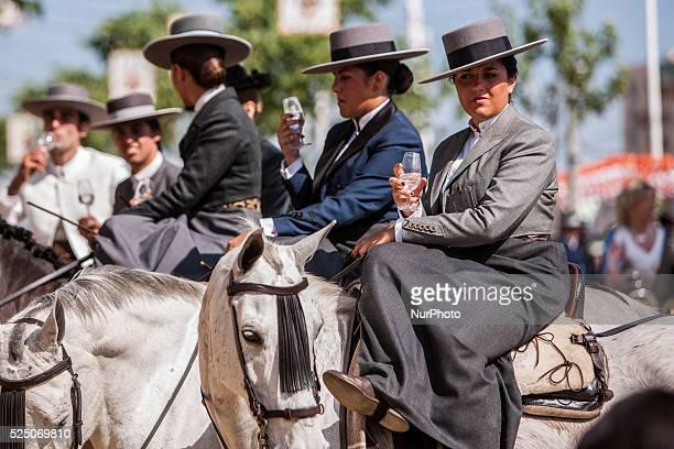 A group of horsewomen drink at the quotFeria de Abrilquot Seville Spain 22 april 2015