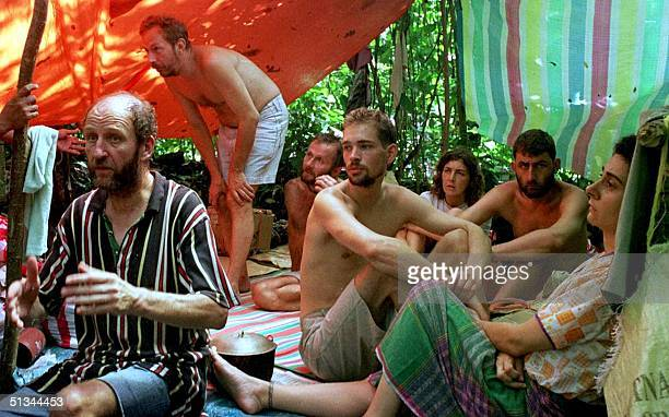 Group of hostages are gathered at an improvised shelter at the jungle camp of the Abu Sayyaf extremist rebels in Jolo island 02 June 2000. The 21...
