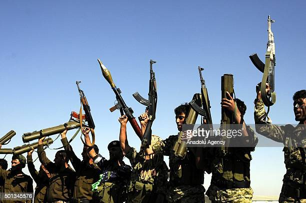 A group of Houthis members perform during a military training session at a camp in Nuqom region of Sanaa Yemen on December 14 2015