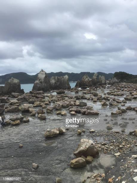group huge rocks extending straight to