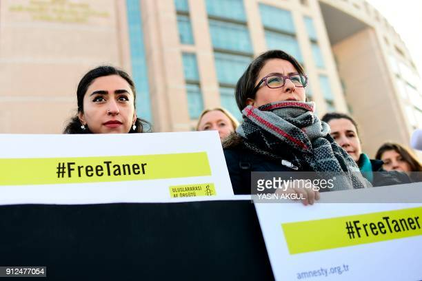 A group of human rights activists gather outside the Caglayan courthouse in Istanbul on January 31 2018 as the trial of eleven human rights activists...