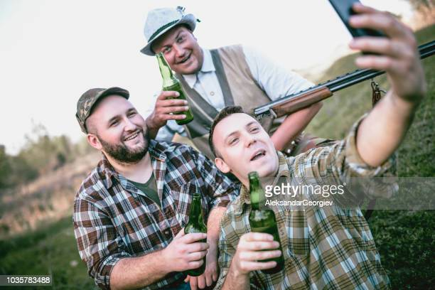 Group of Hunters Taking Selfie and Turn Their Hunting Day into Drinking Party