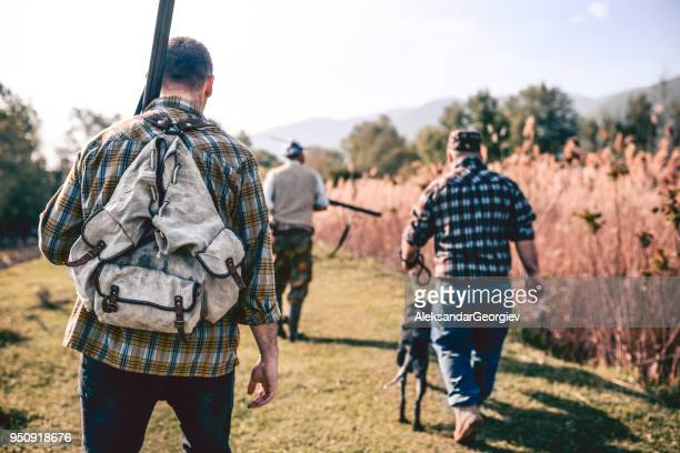 Group of Hunters with Their Dogs Going for Hunting Action