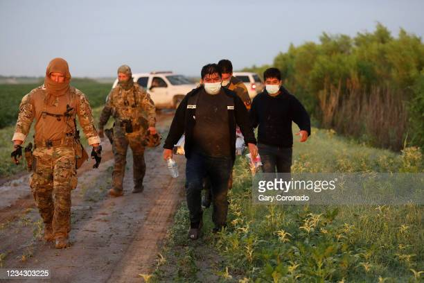 Group of illegal immigrants consisting of Mexicans and Central Americans are caught by the U.S. Border Patrol, Rio Grande Valley Sector, after...
