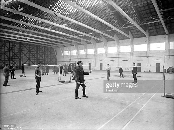 A group of immigrants playing badminton at St Joseph's college in Mill HIll London which is used as a hostel for immigrants