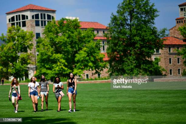 A group of incoming freshmen walk through campus after moving into dormitories at University of Colorado Boulder on August 18 2020 in Boulder...