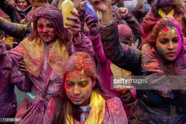 A group of India people are seen throwing colored powders during the procession Millions of people around the world celebrate the annual Holi Hangámá...